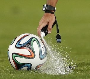 Referee Carlos Velasco of Spain marks a line with a spray during their semi final soccer match between Raja Casablanca and Atletico Mineiro at the Club World Cup soccer tournament in Marrakech, Morocco, Wednesday, Dec. 18, 2013. FIFA  referees use vanishing spray to mark out the distance for a defensive wall from a free kick. The spray is popular in South America but is not widely used elsewhere. Vanishing spray is unlikely to be used at the World Cup in Brazil. (AP Photo/Matthias Schrader)